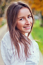 Ukrainian girl Karina,30 years old with grey eyes and light brown hair.