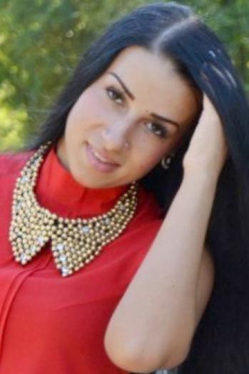 Ukrainian girl Anastasia,23 years old with brown eyes and black hair.