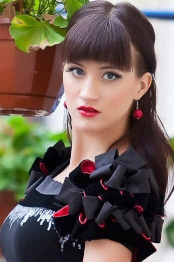 Ukrainian girl Lera ,25 years old with blue eyes and light brown hair.