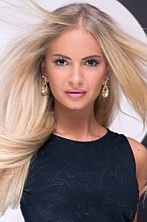 Ukrainian girl Viktoria,27 years old with green eyes and blonde hair.