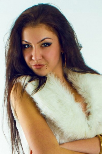 Ukrainian girl Oksana,19 years old with grey eyes and black hair.