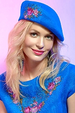 Ukrainian girl Olga,35 years old with green eyes and blonde hair.