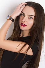 Ukrainian girl Alice,25 years old with blue eyes and black hair.