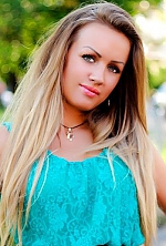 Ukrainian girl Olga,30 years old with grey eyes and light brown hair.