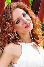 Ukrainian girl Victoria,25 years old with green eyes and red hair.