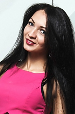 Ukrainian girl Irina,26 years old with green eyes and black hair.