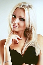 Ukrainian girl Irina,27 years old with grey eyes and blonde hair.