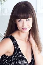 Ukrainian girl Tatiana,30 years old with blue eyes and light brown hair.