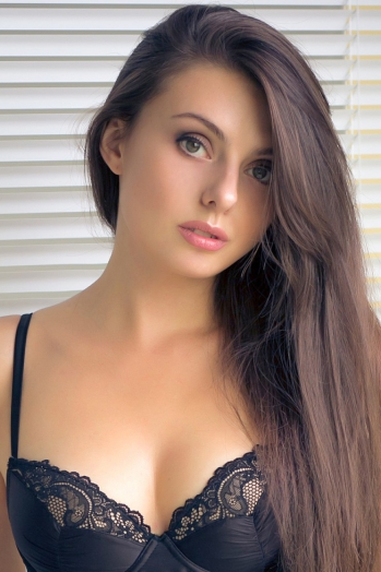 Ukrainian girl Evgenia,27 years old with green eyes and light brown hair.