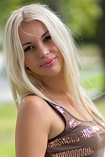 Ukrainian girl Anna,32 years old with brown eyes and blonde hair.