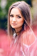 Ukrainian girl Aleksandra,21 years old with brown eyes and dark brown hair.