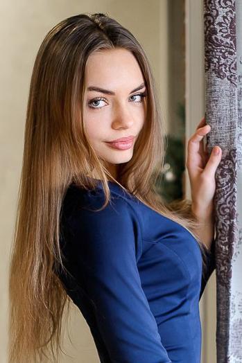 Ukrainian girl Natalya,25 years old with green eyes and light brown hair.