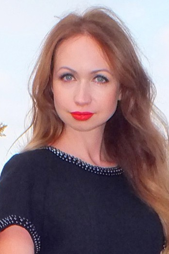 Ukrainian girl Anastasia,32 years old with blue eyes and red hair.