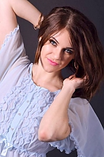 Ukrainian girl Yana,25 years old with blue eyes and light brown hair.