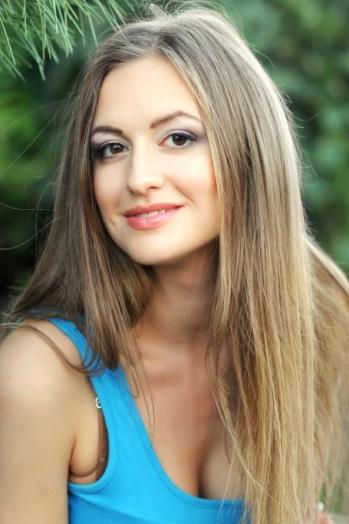 Ukrainian girl Tamara,27 years old with hazel eyes and blonde hair.