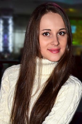 Ukrainian girl Natalya,24 years old with brown eyes and dark brown hair.