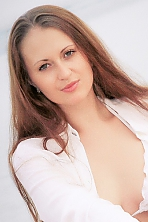Ukrainian girl Svetlana,24 years old with green eyes and light brown hair.
