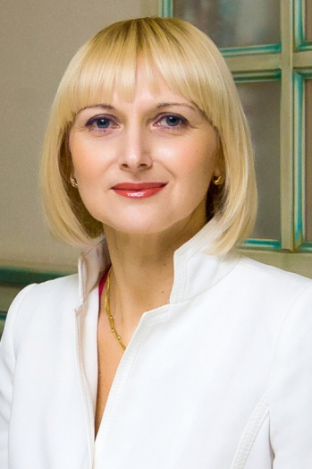 Ukrainian girl Oksana,43 years old with grey eyes and blonde hair.