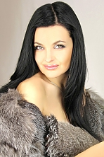 Ukrainian girl Roksolana,38 years old with green eyes and black hair.