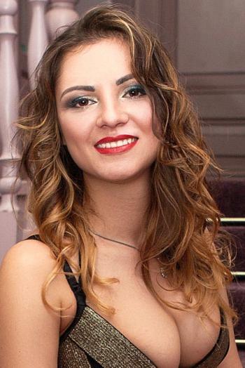 Ukrainian girl Anastasia,24 years old with brown eyes and light brown hair.
