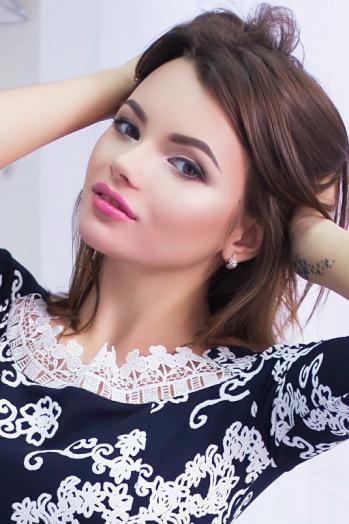 Ukrainian girl Kristina,20 years old with brown eyes and dark brown hair.