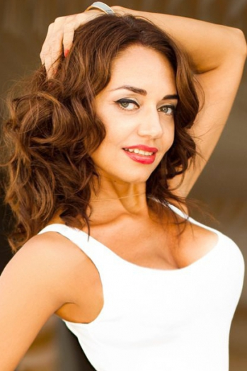 Ukrainian girl Ludmila,45 years old with green eyes and light brown hair.