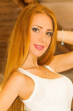 Ukrainian girl Tatiana,25 years old with green eyes and red hair.