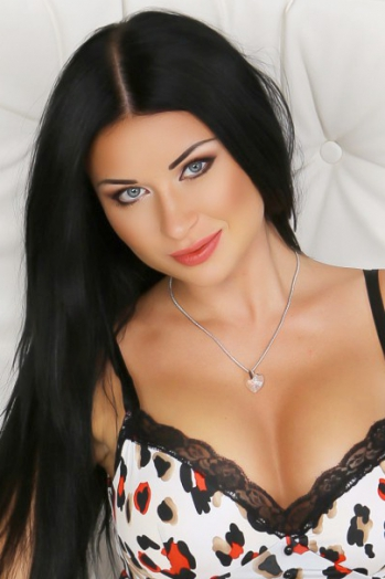 Ukrainian girl Marina,32 years old with blue eyes and black hair.