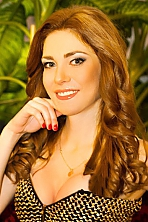 Ukrainian girl Marina,29 years old with green eyes and light brown hair.