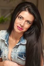 Ukrainian girl Alena,32 years old with brown eyes and black hair.