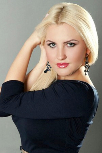 Ukrainian girl Elena,25 years old with blue eyes and blonde hair.