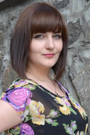 Ukrainian girl Irina,25 years old with green eyes and black hair.