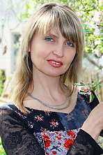 Ukrainian girl Oksana,47 years old with brown eyes and dark brown hair.