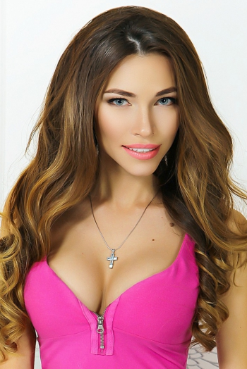 Ukrainian girl Ludmila,25 years old with green eyes and light brown hair.