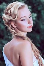Ukrainian girl Anastasia,20 years old with green eyes and blonde hair.
