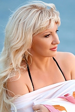 Ukrainian girl Natalia,43 years old with brown eyes and blonde hair.