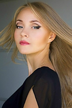 Ukrainian girl Maria,21 years old with blue eyes and blonde hair.