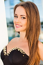 Ukrainian girl Dina,21 years old with brown eyes and dark brown hair.
