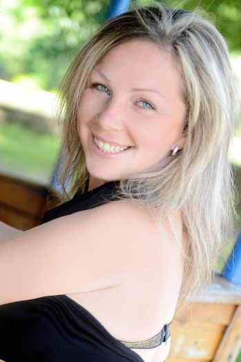 Ukrainian girl Nadya,33 years old with blue eyes and blonde hair.