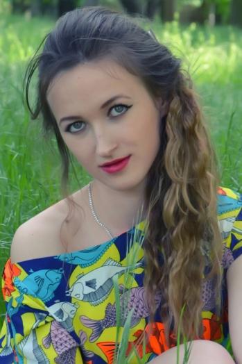 Ukrainian girl Irina,23 years old with green eyes and light brown hair.