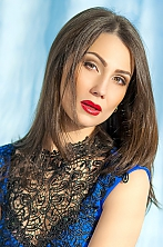 Ukrainian girl Nina,30 years old with brown eyes and dark brown hair.