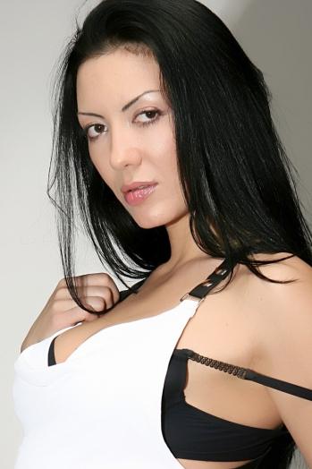 Ukrainian girl Irina,43 years old with brown eyes and black hair.