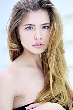 Ukrainian girl Julia,24 years old with blue eyes and light brown hair.