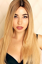 Ukrainian girl Maria,20 years old with brown eyes and blonde hair.
