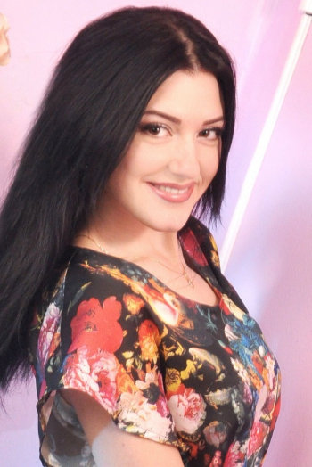 Ukrainian girl Oksana,25 years old with hazel eyes and black hair.
