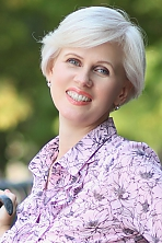 Ukrainian girl Inna,42 years old with grey eyes and blonde hair.