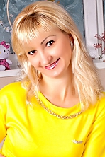 Ukrainian girl Oksana,37 years old with brown eyes and blonde hair.