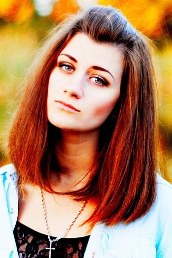 Ukrainian girl Ekaterina,20 years old with green eyes and dark brown hair.