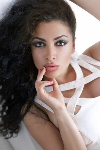 Ukrainian girl Vladlena,26 years old with hazel eyes and black hair.