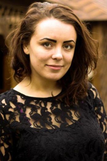 Ukrainian girl Nadegda ,20 years old with brown eyes and dark brown hair.